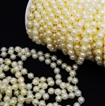10mm Strung Plastic Pearls - Ivory